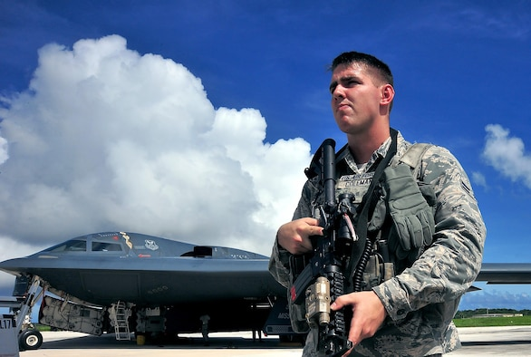 U.S. Air Force Airman 1st Class Chase Coleman, an entry controller with the 509th Security Forces Squadron from Whiteman Air Force Base, Mo., stands guards at an entry control point Aug. 10, 2016 at Andersen Air Force Base, Guam. The United States maintains a strong, credible bomber force that enhances the security and stability of allies and partners around the globe. (U.S. Air Force photo by Senior Airman Jovan Banks)