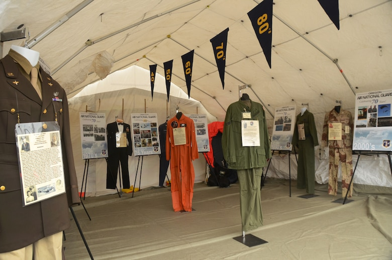 A military tent from the 142nd Fighter Wing helps display historical uniforms and photographs to celebrate the 75th Anniversary of the Oregon Air National Guard, Hillsboro, Ore., Aug. 7, 2016. (U.S. Air National Guard photo by Tech. Sgt. John Hughel, 142nd Fighter Wing Public Affairs/Released).