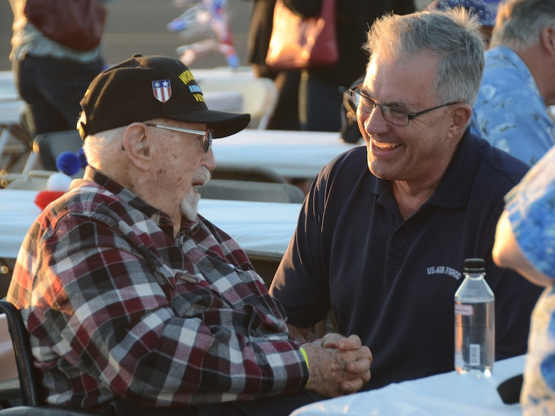 "Fred Parrish, an original founding member of the Oregon Air National Guard, left, enjoys a converstation with Maj. (ret.) Mike Allegre, left, during the afterhours ""All Call"" celebration as part of the 75th Anniversary of the Oregon Air National Guard during the Oregon International Air Show, Hillsboro, Ore., Aug. 6, 2016. (U.S. Air National Guard photo by Tech. Sgt. John Hughel, 142nd Fighter Wing Public Affairs/Released)."