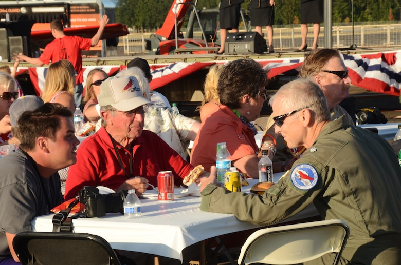 "Current and retired members of the Oregon Air National Guard gather for an afterhours ""All Call"" celebration as part of the 75th Anniversary of the Oregon Air National Guard during the Oregon International Air Show, Hillsboro, Ore., Aug. 6, 2016. (U.S. Air National Guard photo by Tech. Sgt. John Hughel, 142nd Fighter Wing Public Affairs/Released)."