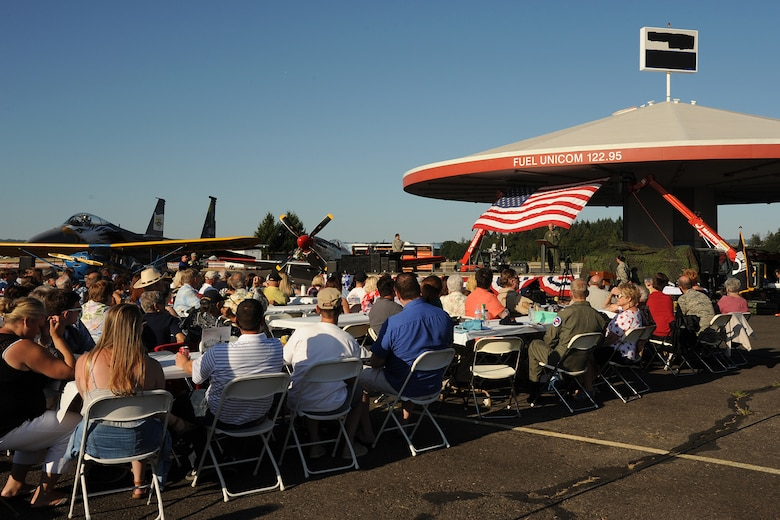 "Current and retired members of the Oregon Air National Guard gather for an afterhours ""All Call"" celebration as part of the 75th Anniversary of the Oregon Air National Guard during the Oregon International Air Show, Hillsboro, Ore., Aug. 6, 2016. (U.S. Air National Guard photo by Master Sgt. Shelly Davison, 142nd Fighter Wing Public Affairs/Released)."