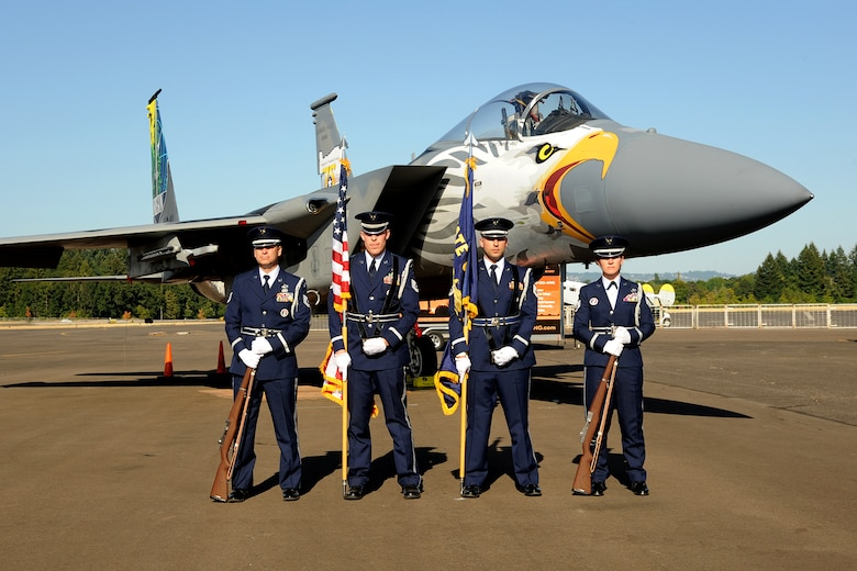 Members of the 142nd Fighter Wing Base Honor Guard team pose for a photograph with an Oregon Air National Guard F-15 Eagle assigned to the 173rd Fighter Wing at the Hillsboro International Airport, Ore., as part of the Oregon International Air Show, Aug. 6, 2016. The 'Screaming Eagle' paint designed is in recognition of the 75th Anniversary of the Oregon Air National Guard. (U.S. Air National Guard photo by Master Sgt. Shelly Davison, 142nd Fighter Wing Public Affairs/Released).