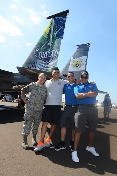 Oregon Air National Guard Recruiters pause for a photo with an F-15 Eagle during the Oregon International Air Show, Hillsboro International Airport, Aug. 6, 2016. (U.S. Air National Guard photo by Tech. Sgt. John Hughel, 142nd Fighter Wing Public Affairs/Released).