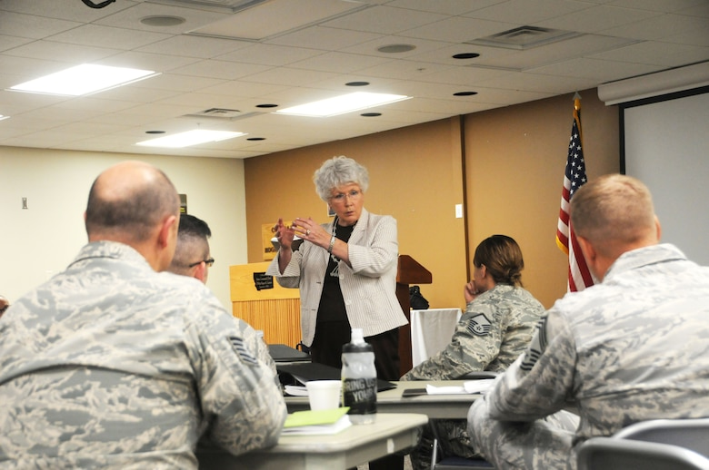 Maggie Bonner teaches flag etiquette to members of the 120th Airlift Wing in the Larsen Room of the 120AW Headquarters Building July 27, 2016. Bonner was teaching a protocol class for the Montana Air National Guard Airmen. (U.S. Air National Guard photo by Senior Master Sgt. Eric Peterson)