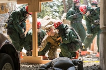 U.S. Army and Air Force Airmen and Soldiers, assigned to the search and extraction team (S&E), Colorado National Guard, train with an evaluator to build wood stabilizers under concrete tunnels and slabs to ensure the safety of S&E teams, when rescuing people from a simlulated chemical attack during a joint exercise evaluation (EXEVAL) at Camp Rilea, Warrenton, Oregon, on Aug. 3, 2016. The EXEVAL ran for five days in a crawl, walk, run sequence, where they started off slowly, then transitioned into rapid response on evaluation day. (U.S. Air National Guard photo by Staff Sgt. Bobbie Reynolds)