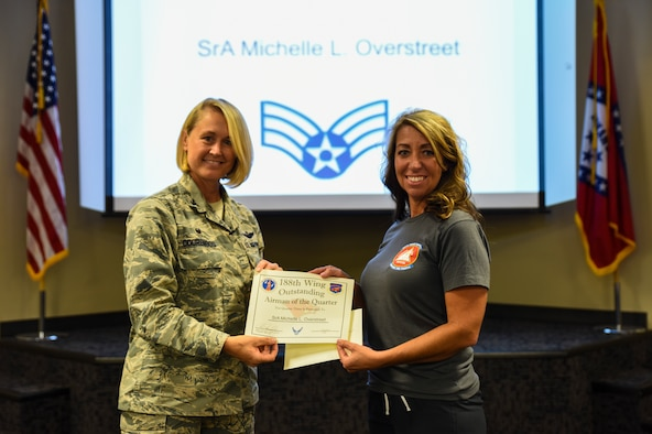 Staff Sgt. Michelle Overstreet, 188th Force Support Squadron, is named the 188th Outstanding Airman of the Quarter Aug. 6, 2016, for fiscal year 2016 quarter three at Ebbing Air National Guard Base, Fort Smith, Ark. The Outstanding Airman of the Quarter program promotes professional development, innovation and mission success by recognizing those who excel in their carrier fields while fostering the cultivation of ready, responsive and highly-skilled Airman. The award was presented to Overstreet by Col. Bobbi Doorenbos, 188th Wing commander. (U.S. Air National Guard photo by Senior Airman Cody Martin)