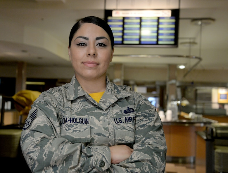 U.S. Air Force Staff Sgt. Christy Garcia-Holguin, 100th Force Support Squadron food service shift leader, poses for a photo at a dining facility Aug. 12, 2016, on RAF Mildenhall, England. Garcia-Holguin earned the Square D Spotlight for exhibiting the Air Force's core value: Excellence in All We Do. (U.S. Air Force photo by Senior Airman Justine Rho)