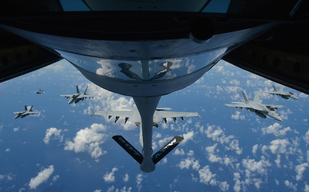 160720-F-EW270-248 JOINT BASE PEARL HARBOR-HICKAM (July 20, 2016) Six U.S. Navy F-18 Hornets await refueling from a KC-135R Stratotanker belonging to the 507th Air Refueling Wing at Tinker Air Force Base, Okla., during Rim of the Pacific 2016. Twenty-six nations, more than 40 ships and submarines, more than 200 aircraft, and 25,000 personnel are participating in RIMPAC from June 30 to Aug. 4, in and around the Hawaiian Islands and Southern California. The world's largest international maritime exercise, RIMPAC provides a unique training opportunity that helps participants foster and sustain the cooperative relationships that are critical to ensuring the safety of sea lanes and security on the world's oceans. RIMPAC 2016 is the 25th exercise in the series that began in 1971. (U.S. Air Force photo by Tech. Sgt. Lauren Gleason)