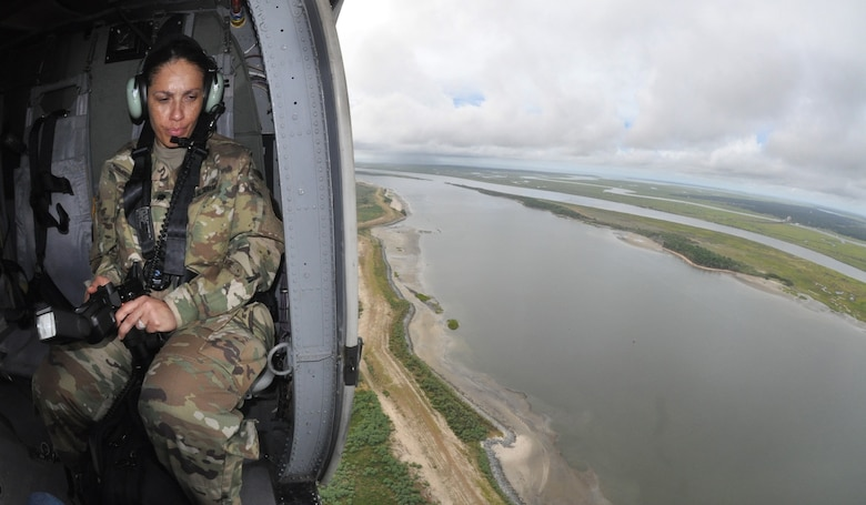 Lt. Col. Reneé Russo-Johnson, an Army public affairs officer, observes the outer harbor and shipping channel in Savannah, Georgia, Aug. 11, 2016. Russo-Johnson was part of team accompanying Under Secretary of the Army Patrick Murphy. The Savannah District of the U.S. Army Corps of Engineers maintains the Savannah harbor and is currently deepening it an additional 5 feet to accommodate larger, post-Panamax container vessels.
