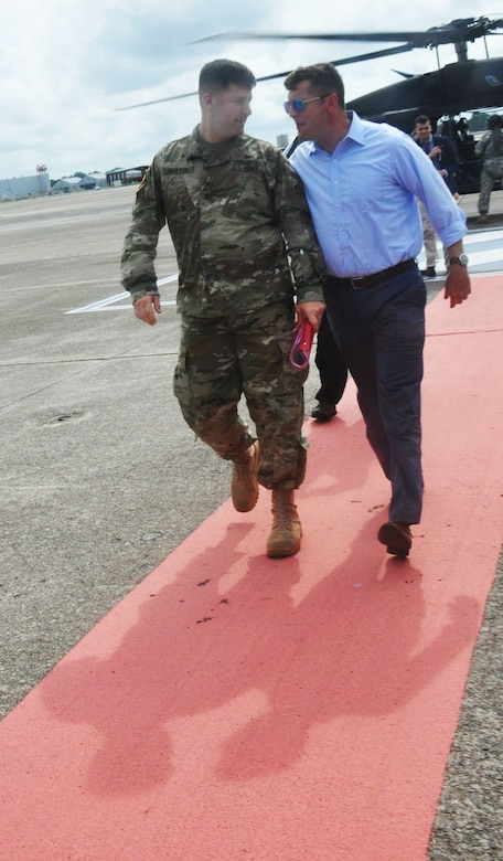 Col. Marvin Griffin, commander of the Savannah District, U.S. Army Corps of Engineers, accompanies Undersecretary of the Army Patrick Murphy after a helicopter tour of the Savannah harbor on Aug. 11, 2016. Murphy took an aerial tour of the harbor as part of his visit to Fort Stewart and Hunter Army Airfield in Georgia. The Savannah District is responsible for maintaining the Savannah harbor and is in the process of deepening it an additional 5 feet to better accommodate larger, post-Panamax container ships, as part of the Savannah Harbor Expansion Project (SHEP).
