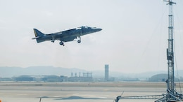 A U.S. Marine Corps AV-8B Harrier with Marine Attack Squadron 542 performs a vertical landing while using the lights on the mobile Expeditionary Hover Position Indicator to adjust its position at Marine Corps Air Station Iwakuni, Japan, Aug. 9, 2016. VMA-542 is home based out of Marine Corps Air Station Cherry Point, N.C., and is forward deployed to MCAS Iwakuni, Japan, as part of the unit deployment program. The Harrier pilots used the mobile EHPI in coordination with Aircraft Recovery assigned to Headquarters and Headquarters Squadron to recertify on boat-deck landings to prepare for other future operations in the Pacific.