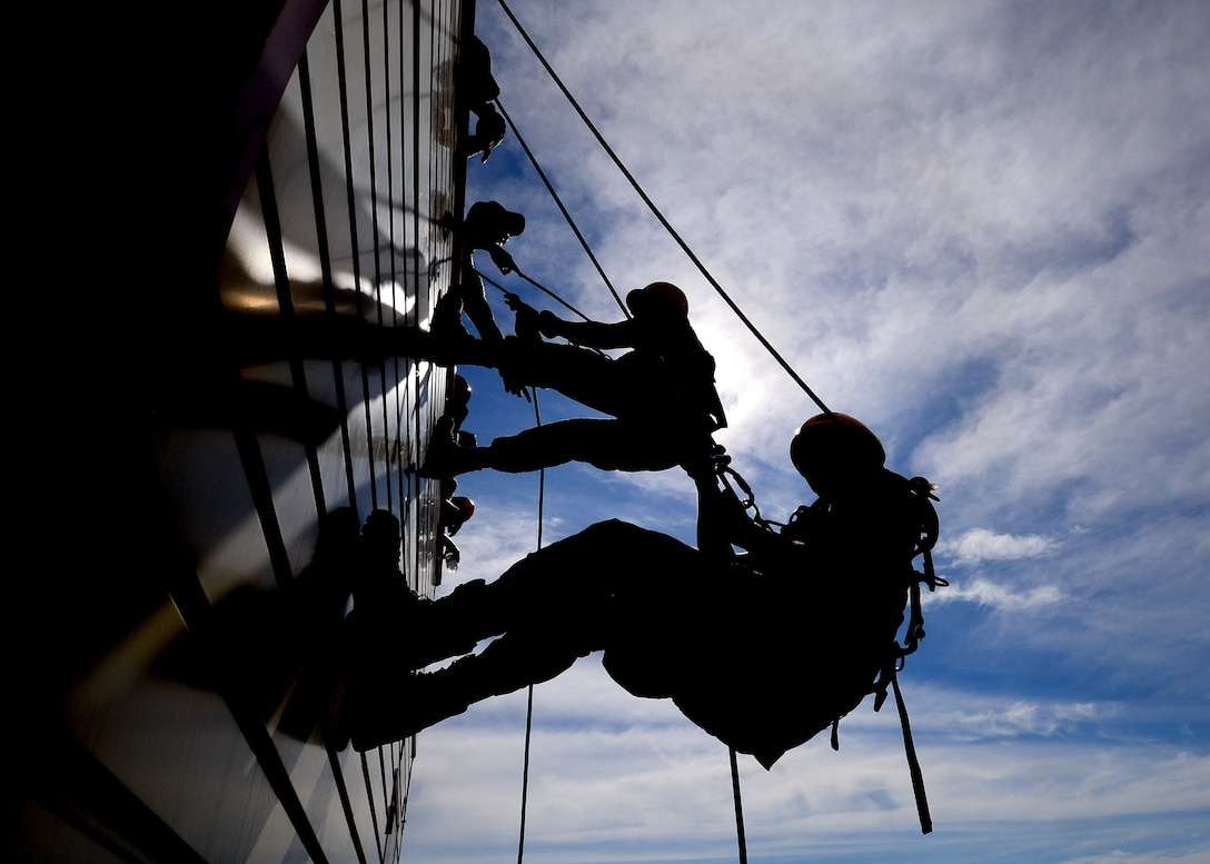 Firefighters from the 31st Civil Engineer Squadron rappel down the side of a building during a Rescue Technician One course at Aviano Air Base, Italy, Aug. 8, 2016. Fourteen Aviano firefighters participated in the training to learn how to conduct low angle, high angle and confined space rescues. (U.S. Air Force photo/Senior Airman Areca T. Bell)