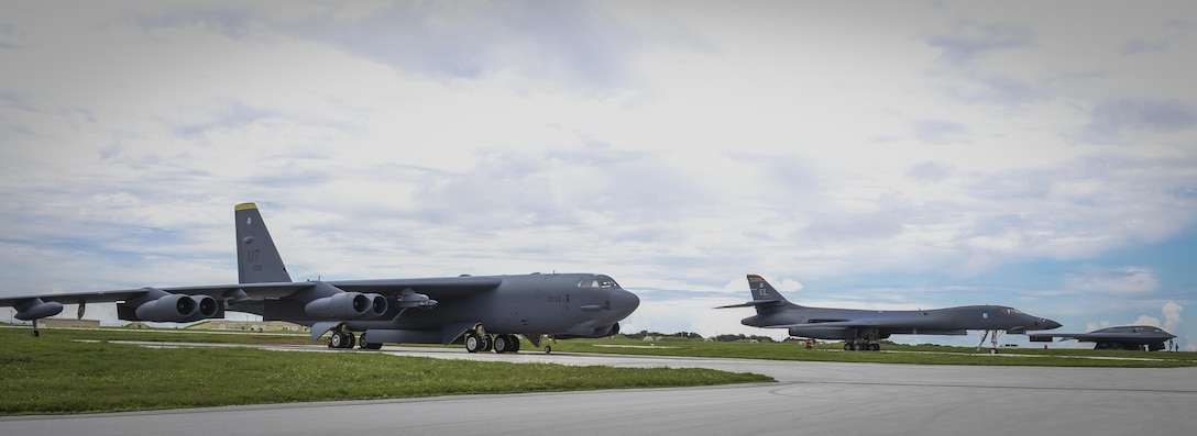 A B-52 Stratofortress, B-1B Lancer and B-2 Spirit sit beside one another on the flightline at Andersen Air Force Base, Guam, Aug.10, 2016. The occasion marked the first time in history that all three of Air Force Global Strike Command's strategic bombers were positioned to simultaneously conduct operations in the U.S. Pacific Command region. (U.S. Air Force photo/Tech. Sgt. Richard Ebensberger)