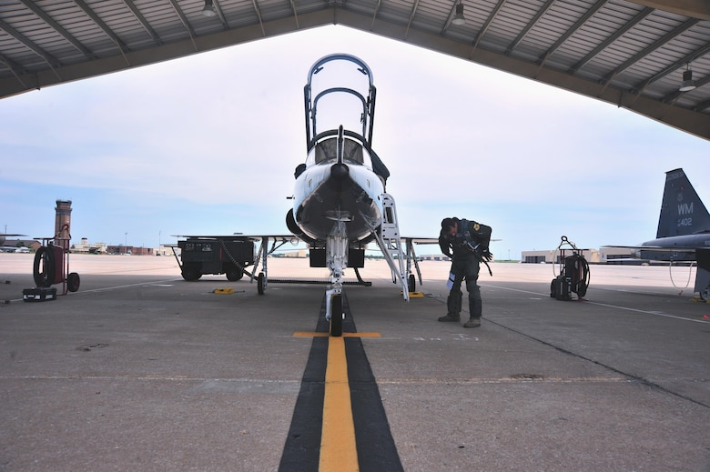 U.S. Air Force Maj. Michael Granberry, the 394th Combat Training Squadron T-38 Talon assisted director of operations of the Companion Trainer Program (CTP), adjusts his gear prior to boarding a T-38 Talon aircraft at Whiteman Air Force Base, July 12, 2016. Unsecured gear during in-flight emergencies can lead to complications during egress procedures.