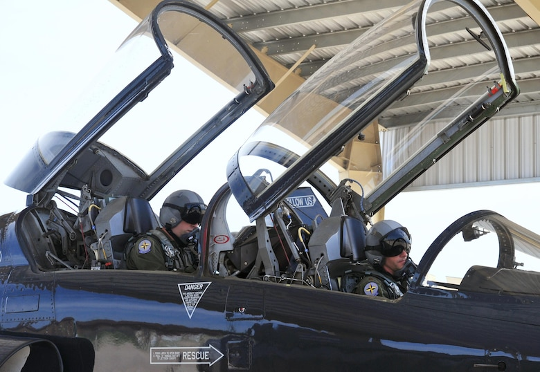 U.S. Air Force Maj. Michael Granberry, the 394th Combat Training Squadron T-38 Talon assisted director of operations of the Companion Trainer Program (right) and Capt. William Jensen, a pilot assigned to the 394th Combat Training Squadron, prepare for takeoff in a T-38 Talon aircraft at Whiteman Air Force Base, July 12, 2016. Pilots must fly the required amount of sorties a month to maintain combat mission ready status.