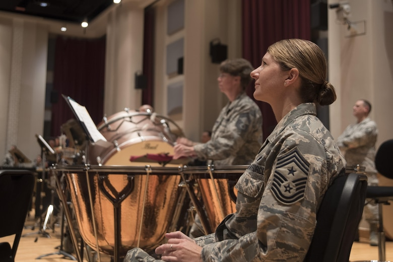 Chief Master Sergeant Beth Topa, 11th Wing command chief master sergeant, listens to a performance by the U.S. Air Force Concert Band during an immersion tour at Joint Base Anacostia-Bolling in Washington, D.C., Aug. 9, 2016. The purpose of the visit was for Col. E. John Teichert, 11th WG and Joint Base Andrews commander, and Topa to become more familiar with the U.S. Air Force Band and Honor Guard missions. (U.S. Air Force Photo by Airman 1st Class Rustie Kramer)