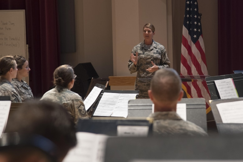 Chief Master Sergeant Beth Topa, 11th Wing command chief master sergeant, speaks to members of the U.S. Air Force Concert Band during an immersion tour at Joint Base Anacostia-Bolling in Washington, D.C., Aug. 9, 2016. The purpose of the visit was for Col. E. John Teichert, 11th WG and Joint Base Andrews commander, and Topa to become more familiar with the U.S. Air Force Band and Honor Guard missions. (U.S. Air Force Photo by Airman 1st Class Rustie Kramer)