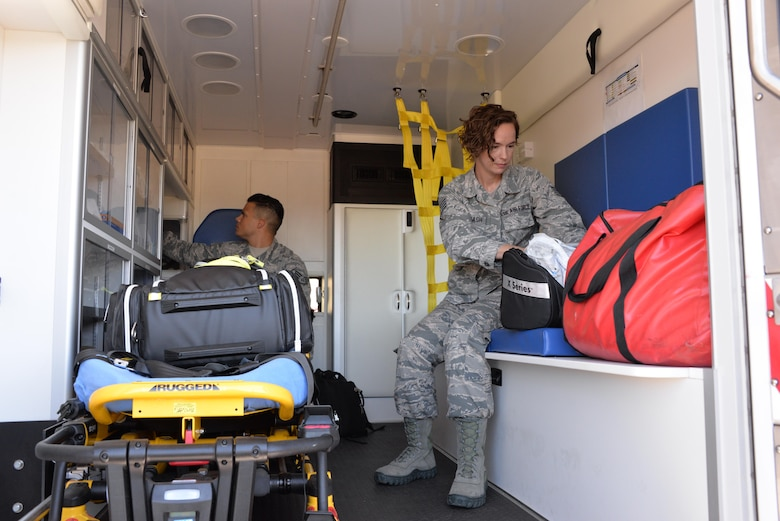Staff Sgt. Emily Overcash and Staff Sgt. Benny Algarin, 60th Aerospace Medicine Squadron operational medical technicians, perform item inspections at Travis Air Force Base, California, Aug. 1, 2016. Operational medical technicians respond to inflight emergencies and take care of flyers. They also handle profiles, retraining, separations and medical evaluation boards for non-flyers. (U.S. Air Force photo by Senior Airman Amber Carter)