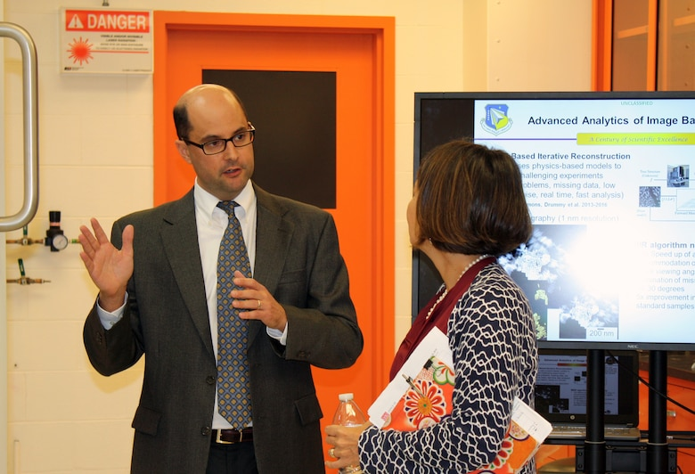 Dr. Lawrence Drummy, a material scientist is the Functional Materials Division, Materials and Manufacturing Directorate, Air Force Research Lab (left) provides an overview of current research in Nano Tomography for Dr. Stephanie Tompkins, Director, Defense Sciences Office, Defense Advanced Research Projects Agency, during a visit to AFRL Materials and Manufacturing Directorate, Aug. 11. During her visit, Tompkins was briefed on current research trends and activity in Nano tomography, materials characterization, additive manufacturing and the benefits of real-time analytics in development of technology for today's warfighter. As the director of DSO, Tompkins maintains a strong interest in cutting-edge research that can accelerate the development of new technologies for national security.  (U.S. Air Force Photo / Marisa Novobilski)