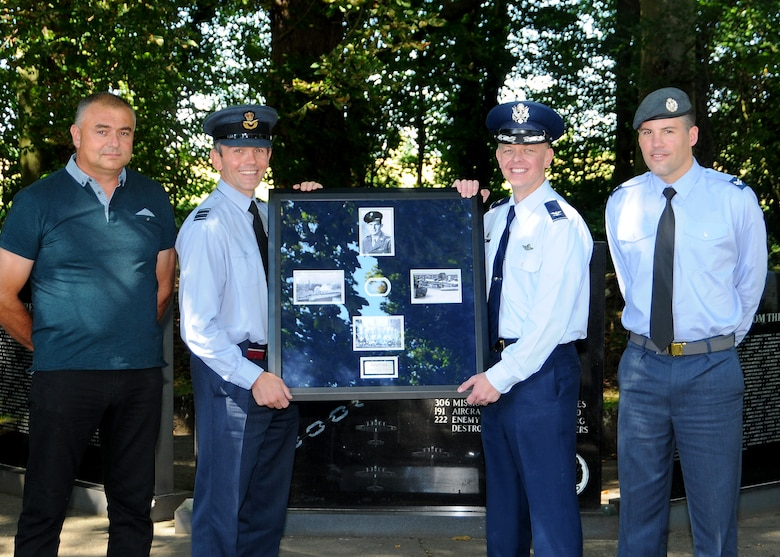 Andy Fuller, dog tag finder, Wing Commander Cornish, officer commanding support wing, Royal Air Force Honington, U.S. Air Force Col. Derek Salmi, 100 Air Refueling Wing, Operations Group commander, RAF Mildenhall, U.K., and Cpl. Ed Stanley, RAF armourer and RAF military contact for Fuller pose in front of the 388th Bombardment Group (Heavy), 8th AF memorial with a WWII U.S. Army Air Forces dog tag that was found while metal detecting on the former RAF Knettishall (US Air Base 136) near Knettishall, U.K., Aug. 12, 2016. This repatriation of the service member's dog tag marked the official receipt from the RAF to the USAF on behalf of the surviving USAAF service member who was assigned to the 388th BG, 8th AF and is currently living in Louisiana. Following this ceremony, the dog tag will be transported to the 8th AF in Louisiana where it can then be officially presented to its rightful owner. (U.S. Air Force photo by Senior Master Sgt. Brian M. Boisvert)
