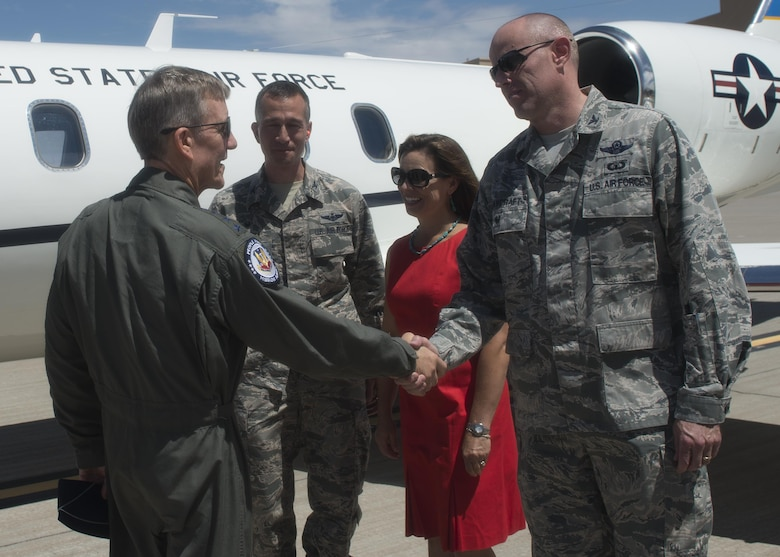 Gen. Hawk Carlisle (left), the commander of Air Combat Command, is greeted by Col. Ryan Craycraft, the 49th Wing vice commander, Aug. 3, 2016 at Holloman Air Force Base, N.M. Carlisle's visit included an all-call to discuss unique strengths of Remotely Piloted Aircraft, reflect on the history of Holloman, and recognize superior performers during a coining ceremony. (U.S. Air Force photo by Staff Sgt. E'Lysia A. Wray)