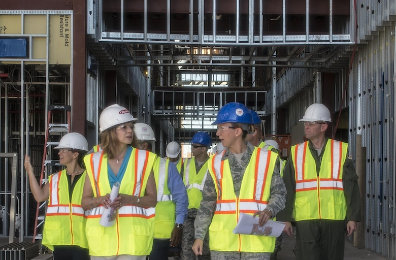 Gillian Carlisle (left), wife of Gen. Hawk Carlisle, the commander of Air Combat Command, walks through the construction site of the 49th Medical Group's new medical clinic Aug. 4, 2016 at Holloman Air Force Base, N.M. Mrs. Carlisle's visit included a meeting with Holloman's key spouses, a tour of Holloman Elementary and Middle schools, and a discussion with Holloman's senior staff and the Sexual Assault Response Coordinator. (U.S. Air Force photo by Staff Sgt. E'Lysia A. Wray)