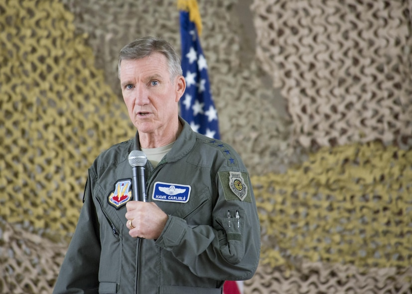 Gen. Hawk Carlisle, the commander of Air Combat Command, discusses unique strengths of the Remotely Piloted Aircraft community during an all-call Aug. 8, 2016 at Holloman Air Force Base, N.M. Carlisle also reflected on the history of Holloman and recognized four superior performers during a coining ceremony at the all-call. (U.S. Air Force photo by Airman 1st Class Randahl J. Jenson)