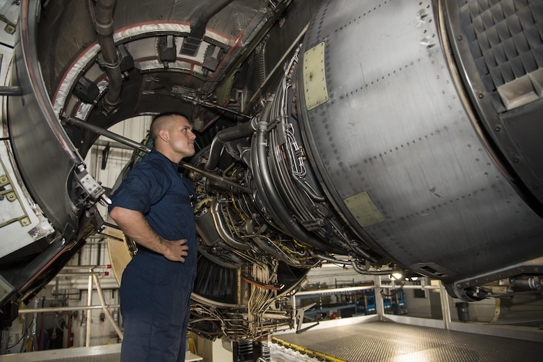 Senior Airman Austin Toniolo, 736th Aircraft Maintenance Squadron crew chief, inspects an engine on a C-17A Globemaster III while standing on a C-17 Engine Maintenance Platform on Aug. 1, 2016, at Dover Air Force Base, Del. Each aircraft is inspected every 120 days in planned routine inspections called home station checks. (U.S. Air Force photo by Senior Airman Aaron J. Jenne)