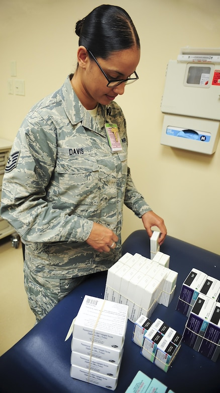 Tech. Sgt. Kimburly Davis, NCO in charge of immunizations assigned to 6th Medical Operations Squadron (MDOS), completes inventory of an arriving vaccines shipment, Aug. 10, 2016 at MacDill Air Force Base, Fla. The 6th MDOS immunizations clinic receives weekly shipments of vaccines worth approximately $30K. (U.S. Air Force photo by Senior Airman Jenay Randolph)