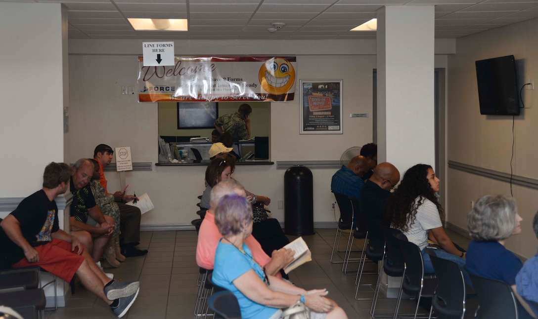 Customers wait to be seen at the Pass and ID card office, Aug. 11, 2016 at MacDill Air Force Base, Fla. The office is relocating Aug. 22-26 and will be minimally manned during that time. Normal operations will resume Aug. 29, 2016. (U.S. Air Force photo by Senior Airman Vernon L. Fowler Jr.)