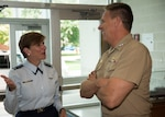 Gen. Lori Robinson, commander, North American Aerospace Defense Command and U.S. Northern Command is greeted by Adm. Phil Davidson, commander, U.S. Fleet Forces (USFF) Command  on the USFF quarterdeck at the start of her visit to Norfolk, Virginia, Aug. 11, 2016. The General's visit included a maritime domain awareness brief at the USFF Maritime Operations Center, a tour of Arleigh Burke-class destroyer USS Gonzalez (DDG 66), and a hall of fame induction ceremony at the Joint Forces Staff College. (U.S. Navy photo by Mass Communication Specialist 2nd Class Benjamin Dobbs/Released)