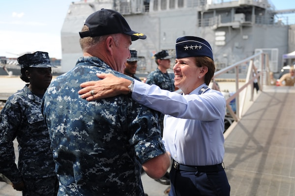 Cmdr. Stefan Walch, commanding officer of Arleigh Burke-class guided-missile destroyer USS Gonzalez (DDG 66) greets Gen. Lori Robinson, Commander North American Aerospace Defense Command and U.S. Northern Command Aug. 11, 2016. The General's visit to Norfolk includes a maritime domain awareness brief at the U.S. Fleet Forces Maritime Operations Center, a tour of Gonzalez and a hall of fame induction ceremony at the Joint Forces Staff College.