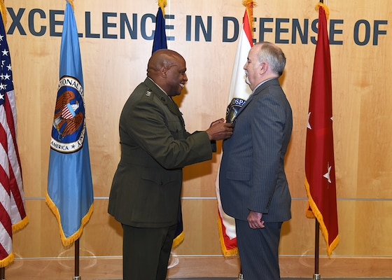 DIA Director Lt. Gen. Vincent Stewart awarded former deputy director, Doug Wise, the Defense Intelligence Director's Award during Wise's retirement ceremony at DIA Headquarters Aug. 11.