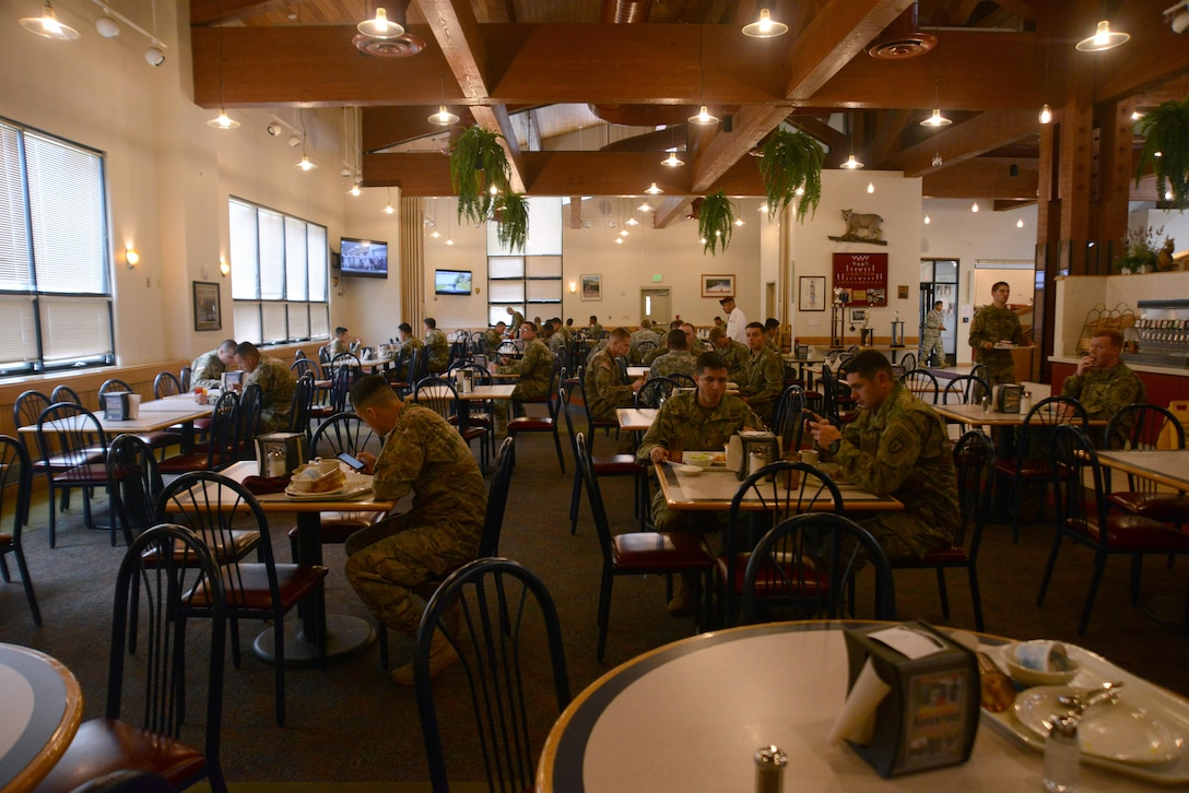 Soldiers eat at the Wilderness Inn dining facility at Joint Base Elmendorf-Richardson, Alaska, July 6, 2016. The Philip A. Connelly award provides recognition for excellence in the preparation and serving of food in Army dining facilities and during field kitchen operations. (U.S. Air Force photo by Airman 1st Class Christopher R. Morales)