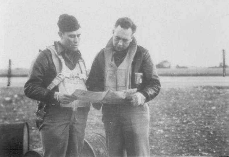 Col. Clifford Heflin, while Commander of the 592nd Bomb Group, also known as the Carpetbaggers, confers with the Group's Intelligence Officer, in 1944. (Courtesy photo)