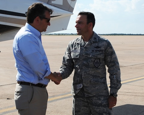 U.S. Air Force Col. David Benson, 7th Bomb Wing commander, greets U.S. Sen. Ted Cruz Aug. 11, 2016, at Dyess Air Force Base, Texas. The purpose of the visit was to introduce Cruz to the base and its mission sets and get a glimpse at a day in the life of the Airmen who support Team Dyess. (U.S. Air Force photo by Senior Airman Kedesha Pennant/Released)