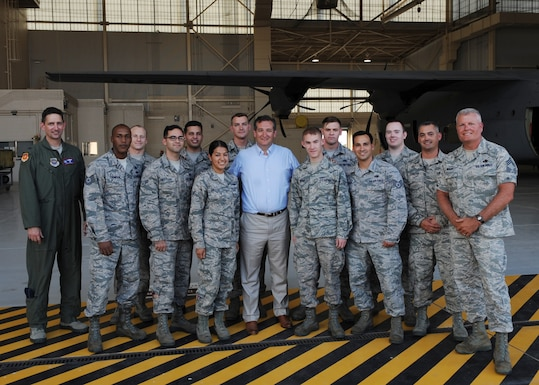 U.S. Sen. Ted Cruz poses for a photo with Airmen assigned to the 317th Airlift Group Aug. 11, 2016, at Dyess Air Force Base, Texas. He was briefed by senior leaders on the capabilities of the 7th Bomb Wing and 317th Airlift Group, toured the base and received an up-close look at the C-130J and B-1B Lancer.