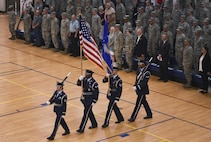 Mile High Honor Guard presents the colors during the 460th Space Wing change of command ceremony August 12, 2016, at the Buckley Fitness Center on Buckley Air Force Base, Colo. The change of command ceremony represents the formal passing of responsibility, authority and accountability of command from one officer to another. (U.S. Air Force photo by Staff Sgt. Katrina M. Brisbin/Released)