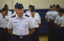 Col. Scott Romberger, 460th Space Wing vice commander, presents the wing August 12, 2016, during the wing's change of command ceremony at the Buckley Fitness Center on Buckley Air Force Base, Colo. Buckley AFB defends America through its air operations, space-based missile warning capabilities, space surveillance operations, space communications operations and support functions. (U.S. Air Force photo by Airman 1st Class Gabrielle Spradling/Released)
