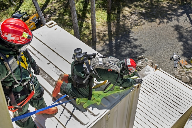 Airmen locate a medical mannequin at the top of a building during training at Camp Rilea, Warrenton, Ore., Aug. 4, 2016. The airmen, assigned to the Colorado National Guard's 140th Fatality Search and Rescue Team, function as a recovery team, helping families find closure after properly identifying those who have lost their lives. Air National Guard photo by Staff Sgt. Bobbie Reynolds