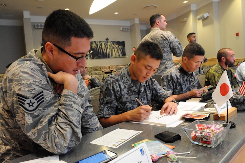 U.S. Air Force Staff Sgt. Ryuta Riecke, left, a linguist assigned to the 8th Intelligence Squadron at Hickam Air Force Base, Hawaii, translates for Japan Air Self-Defense Force Tech. Sgt. Satoshi Kushida, center, during a leadership activity at the first U.S. led, Pacific Rim Junior Enlisted Leadership Forum (JELF) at Joint Base Pearl Harbor-Hickam, Hawaii, Aug 8. 2016. The service members came together from 11 different countries to share experiences and to gain valuable insight on leadership development in order to grow as tomorrow's senior enlisted leaders.  (U.S. Air Force photo by Staff Sgt. Kamaile Chan)