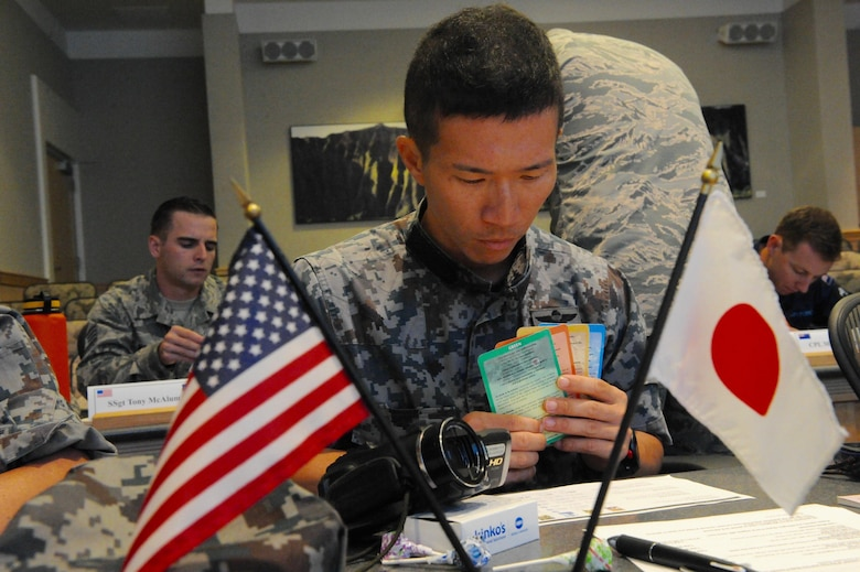 "Tech. Sgt. Yuki Kawagoe, a pararescue jumper with the Japan Air Self-Defense Force, Akita Air Station, Air Rescue Wing, Japan, completes the ""True Colors"" self-assessment during the first U.S. led, Pacific Rim Junior Enlisted Leadership Forum (JELF) at Joint Base Pearl Harbor-Hickam, Hawaii, Aug 8. 2016. The JASDF represented one of the 11 different countries that came together to share experiences and to gain valuable insight on leadership, further developing U.S. alliances and partnerships across the Pacific.  (U.S. Air Force photo by Staff Sgt. Kamaile Chan)"