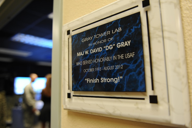 A plaque honoring Maj. W. David Gray hangs outside of a tower lab training room in Cody Hall Aug. 8, 2016, on Keesler Air Force Base, Miss. Gray served for several years as an airfield operations officer and was killed in action in Afghanistan on Aug. 8, 2012. (U.S. Air Force photo by Kemberly Groue/Released)
