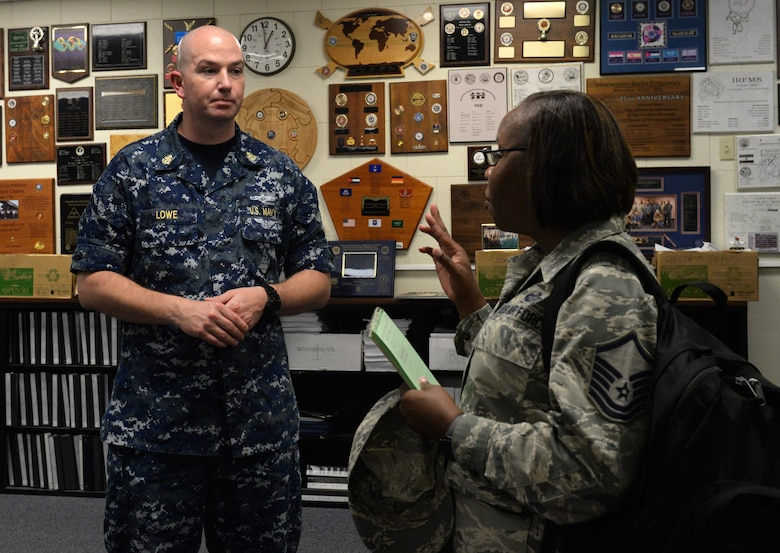 Master Sgt. Alicia Barley, Community College of the Air Force campus affiliations flight chief, asks Navy Chief Petty Officer Noah Lowe, 333rd Training Squadron instructor supervisor, questions about the spectrum operations apprentice course at McClelland Hall Aug. 9, 2016, on Keesler Air Force Base, Miss. The CCAF inspection team visited the 81st Training Group to assess class curriculums to ensure Keesler maintains its accreditation so students can receive college credits for their completed technical schools. (U.S. Air Force photo by Airman 1st Class Travis Beihl/Released)