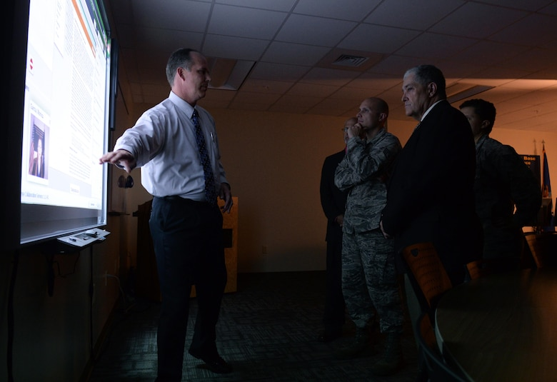 Rick Harman, 81st Training Support Squadron curriculum development manager, demonstrates the online learning broadcast studio's capabilities to members of the Community College of the Air Force inspection team at Allee Hall Aug, 9, 2016, on Keesler Air Force Base, Miss. The CCAF inspection team visited the 81st Training Group to assess class curriculums to ensure Keesler maintains its accreditation so students can receive college credits for their completed technical schools. (U.S. Air Force photo by Airman 1st Class Travis Beihl/Released)