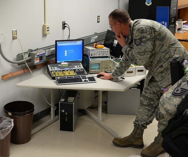 Tech. Sgt. Chad Quesenberry, 335th Training Squadron instructor supervisor, demonstrates the functions of a Nida electronic trainer to members of the Community College of the Air Force inspection team at Wolfe Hall Aug. 10, 2016, on Keesler Air Force Base, Miss. The CCAF inspection team visited the 81st Training Group to assess class curriculums to ensure Keesler maintains its accreditation so students can receive college credits for their completed technical schools. (U.S. Air Force photo by Airman 1st Class Travis Beihl/Released)