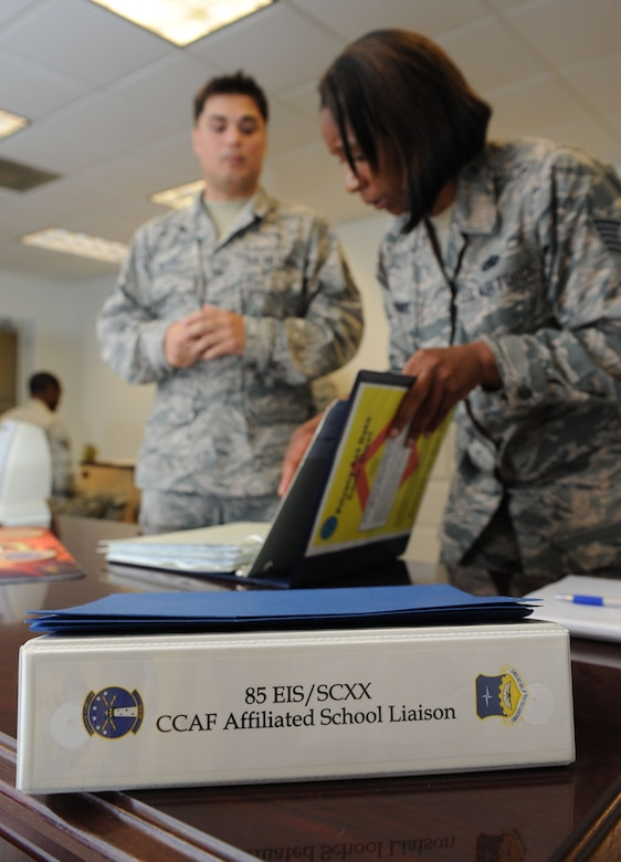 Tech. Sgt. Virgil Putzke, 85th Engineering Installation Squadron force development NCO in charge, assists Tech. Sgt. Benita Casemere, Community College of the Air Force affiliate school manager, during an inspection at Maltby Hall Aug. 11, 2016, on Keesler Air Force Base, Miss. The CCAF inspection team visited the 81st Training Group to assess class curriculums to ensure Keesler maintains its accreditation so students can receive college credits for their completed technical schools. (U.S. Air Force photo by Kemberly Groue/Released)