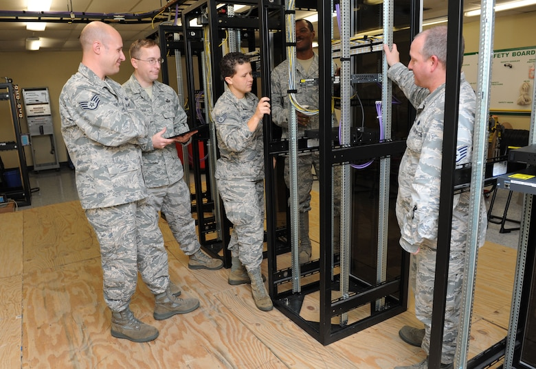 Members of the Community College of the Air Force Compliance Requirements Visit team receive a tour of the 85th Engineering Installation Squadron at Maltby Hall Aug. 11, 2016, on Keesler Air Force Base, Miss. The CCAF inspection team visited the 81st Training Group to assess class curriculums to ensure Keesler maintains its accreditation so students can receive college credits for their completed technical schools. (U.S. Air Force photo by Kemberly Groue/Released)