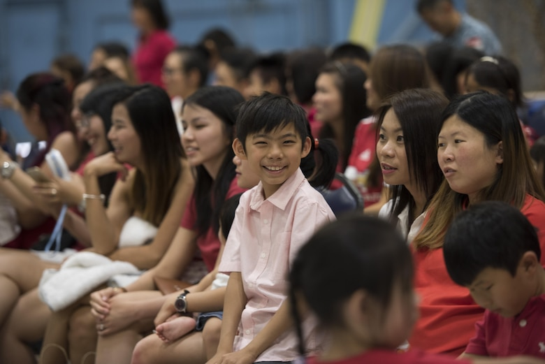 A boy smiles at the camera during the Peace Carvin V National Day day celebration August 5, 2016 at Mountain Home Air Force Base, Idaho. This year's celebration marks Singapore's 51st year of independence from Malaysia. (U.S. Air Force photo by Airman Alaysia Berry/Released)