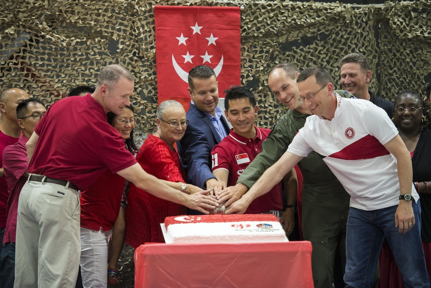 Mountain Home military and civic leaders assist in the cutting of the birthday cake in celebration of Singapore's 51st birthday August 5, 2016, at Mountain Home AFB, Idaho. Singapore celebrated 51 years of independence August 9, 2016. (U.S. Air Force photo by 2nd Lt. Kippun Sumner/Released)